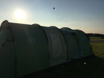 Coleman Cabral tent pitched at peterborough with hot air balloon
